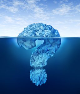 Private information hidden insider knowledge and secret personal or business data as a partialy submerged iceberg in the shape of a question mark symbol as a concept of internet encryption and digital security or illegal trading .